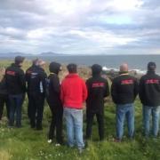 Michael Comber Racing Mazda Mx5 Mk1 Mk3 race team admiring coastline at Anglesey