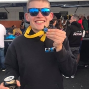 Michael Comber Racing Mazda Mx5 Mk1 Mk3 race driver Charlie Mugglestone shows off 1st place quiz night medal